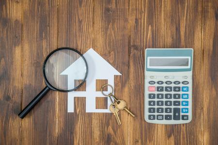 kopen huis hypotheek berekeningen, rekenmachine met vergrootglas Zoeken