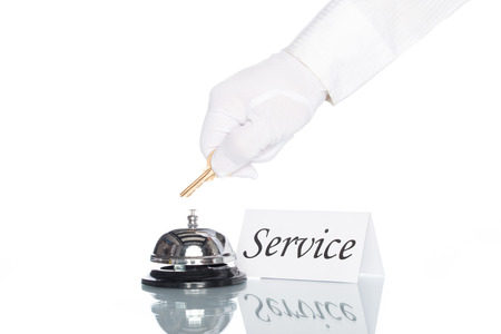 check in: Service bell on the Check in desk with white background