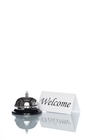 service desk: Service bell and welcome sign on the Check in desk with white background