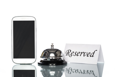 reserved sign: cell phone and Service bell on white background, reserved sign