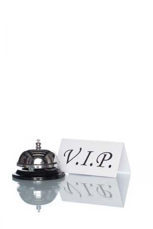 service desk: Service bell and vip sign on the Check in desk with white background