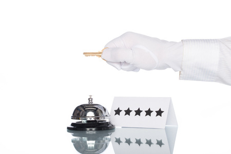 service desk: Service bell and 5 stars sign on the Check in desk with white background Stock Photo