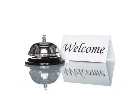 welcome desk: Service bell and welcome sign on the Check in desk with white background