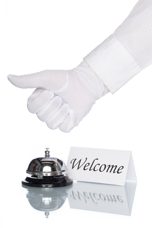 welcome desk: Service bell on the Check in desk with white background, welcome sign