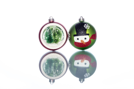 snowglobe with christmas tree inside with snowman on white Background, copy space