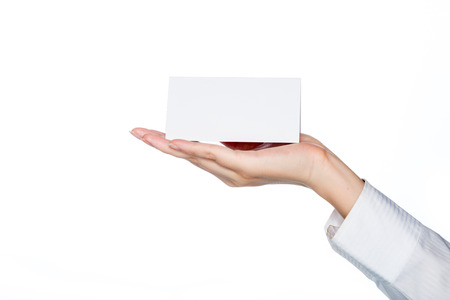 accommodation space: woman hand holding blank card on white background