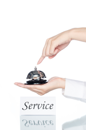 service card: woman hand holding Service bell with service card on white background