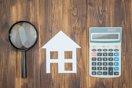 buy house Mortgage calculations concept, calculator with Magnifier