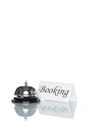 accommodation space: Service bell with booking sign on the desk with white background