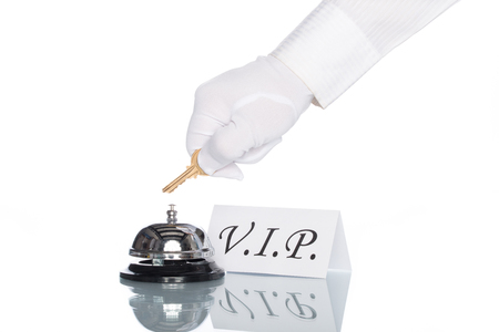 service desk: Service bell and vip sign on the desk with white background Stock Photo