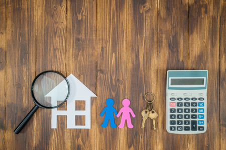 couple buy house concept with calculator and Magnifier