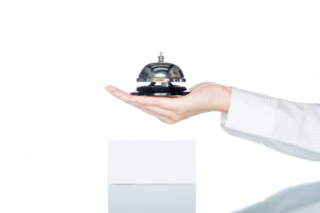 accommodation space: woman hand holding Service bell on white background