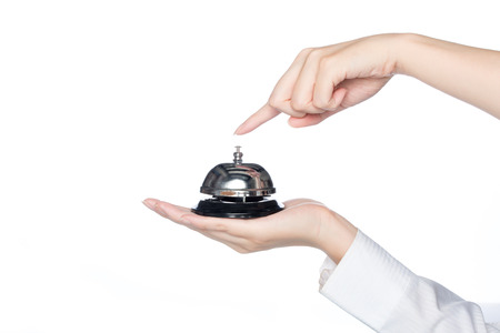 press button: woman hand holding Service bell and press button  on white background Stock Photo