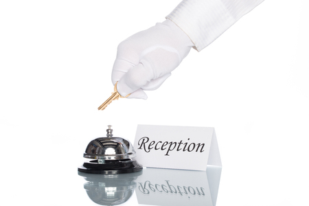service desk: Service bell and reception sign on desk with white background Stock Photo