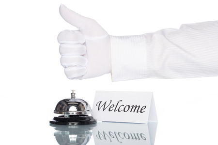 welcome desk: Service bell and welcome sign on desk with white background Stock Photo