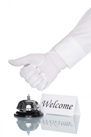 service desk: Service bell and welcome sign on desk with white background Stock Photo