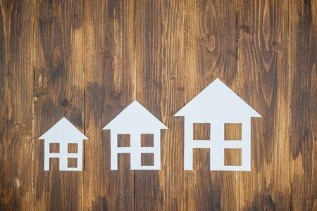 progressive: paper house on wooden background, Progressive concept