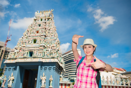 mariamman: Happy young Asia woman framing in Sri Mariamman Temple, Singapore Stock Photo