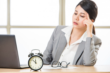 overtime: Exhausted asian Businesswoman overtime and overworked in office Stock Photo
