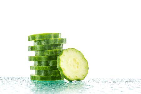 cuke: Fresh Cucumber slices on white background, reflection