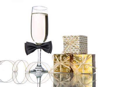 stemware: champagne with gift on white background, celebration holiday Stock Photo