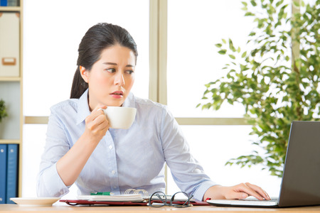sad lady: Young asian business woman overworked with uncomfortable in office