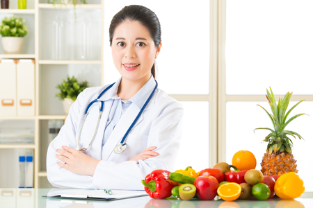 nutritionist: Doctor nutritionist with fruits and vegetable, health eating Stock Photo