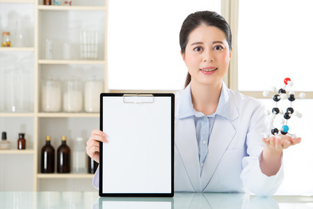 molecular model: Happy smile asian female scientist holding clipboard with molecular model Stock Photo