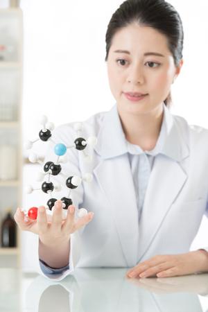molecular model: asian female scientist teacher point at molecular model explain Scientific wonders in laboratory