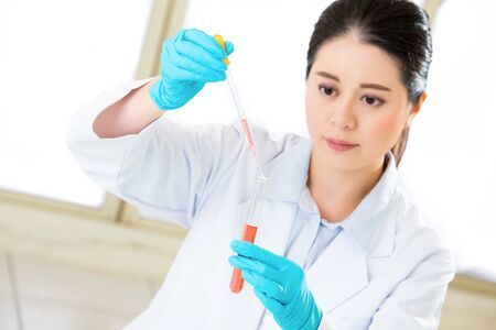 pathologist: scientist breaking scientific boundaries with her research  with gloves