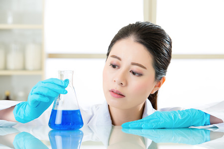 pathologist: Asian female forensic scientist know knowledge is power in laboratory Stock Photo