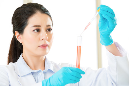 pathologist: Young asian scientist  showing the passionate about chemistry in laboratory