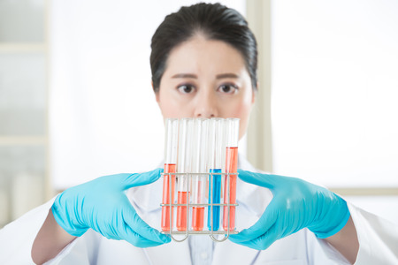 forensic science: Asian female scientist Asian female scientist Finally a breakthrough Examining test in laboratory