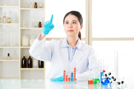 conclusive: professional asian scientist hoping for some conclusive results Stock Photo