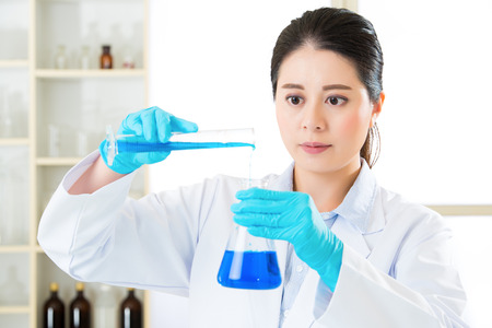 pathologist: Young asian scientist Braving new medical frontiers in laboratory with gloves
