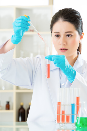 forensic: Asian female forensic scientist know knowledge is power in laboratory Stock Photo