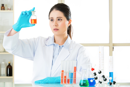 frontiers: Beautiful Asian female biologist Braving new medical frontiers in laboratory Stock Photo