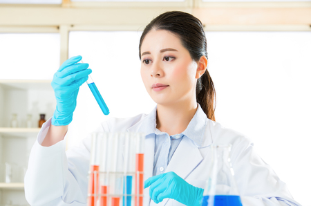 conclusive: scientist she hoping for some conclusive results after examining Stock Photo
