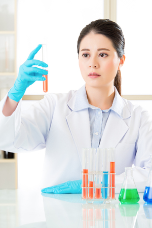 forensic: Asian female forensic scientist doing research and development  in laboratory