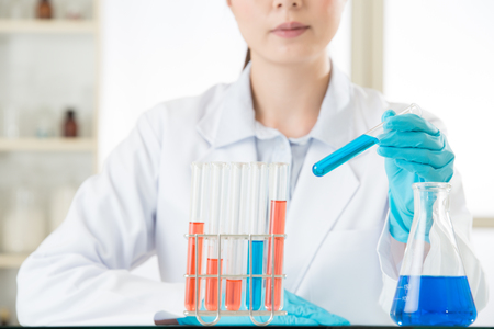 pathologist: Young asian scientist pipetting in life science in laboratory with gloves