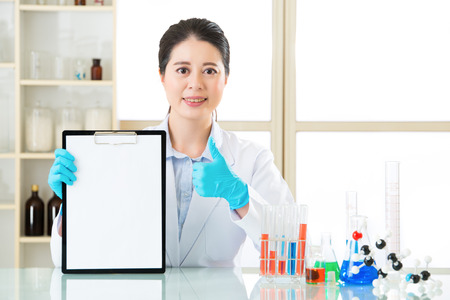 pathologist: happy female scientist discover good result and thumb up with smile face Stock Photo