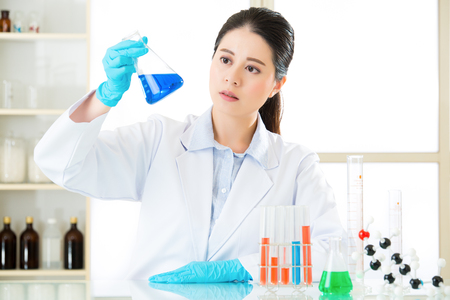 pathologist: beautiful asian female chemist braving new medical frontiers in laboratory