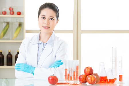 Asian female scientist looking for cure for genetic modification food in laboratory Stock Photo