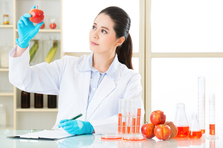 modification: scientist Recording genetic modification data from examining in laboratory