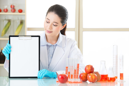apple gmo: looking clipboard to recording gmo food test result in laboratory