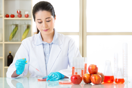 Asian female scientist research for genetic modification solution in laboratory