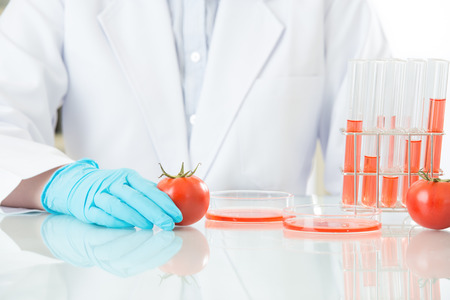Asian female scientist testing genetic modification food will be ok for human