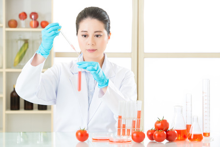 modification: Asian female scientist drop to do genetic modification research in laboratory Stock Photo