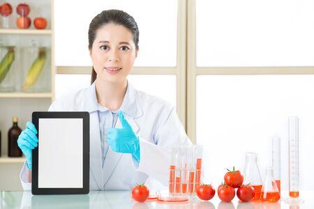 genetic food modification: genetic modification food are good for human health by digital tablet Stock Photo