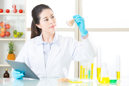 if you not sure about gmo food, do your home work on internet by Digital Tablet Stock Photo